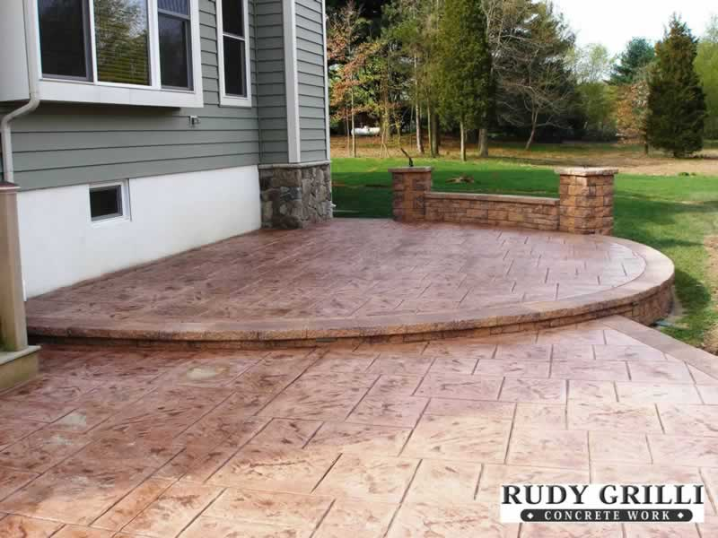 Pin Raised Patio Constructed From Reclaimed Materials on